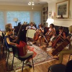 Coaches Carolyn Hancock (violin) and Dona Velek (cello) work with students